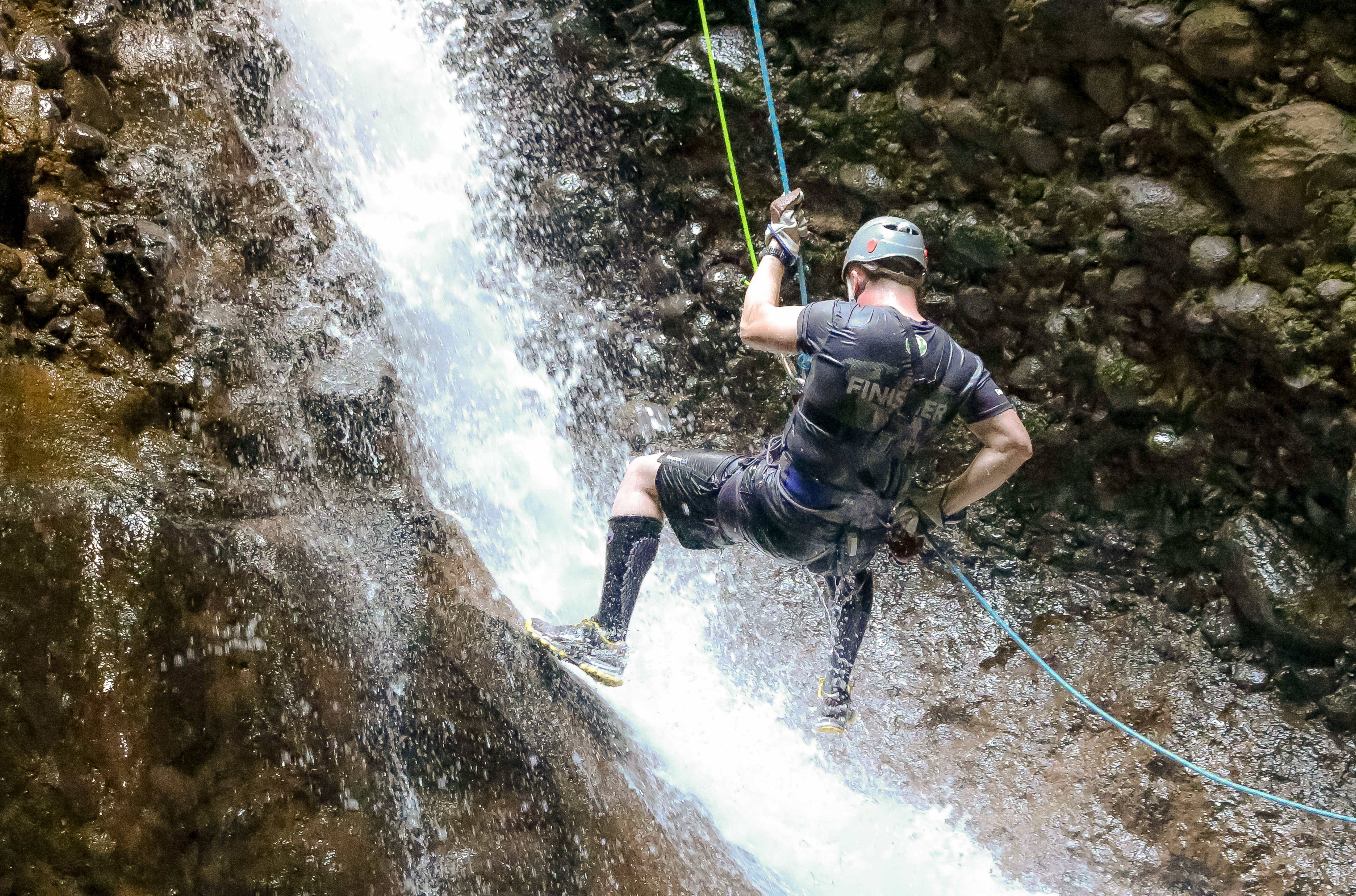 Rappelling down a waterfall.