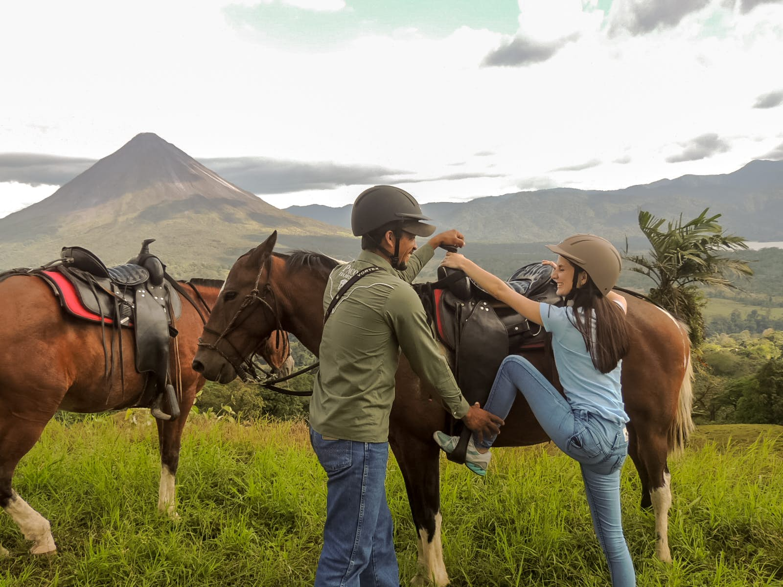 Expert Guide gives horseback riding instructions to visitor.