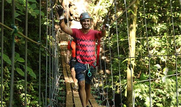Crossing a hanging bridge.